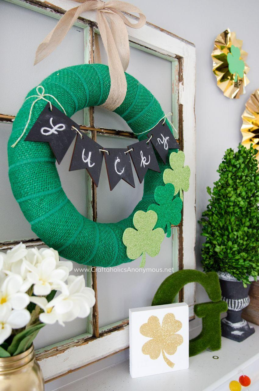 "<p>It's difficult to believe, but this jazzy St. Pat's door hanger can be easily made by wrapping green burlap over a straw wreath form. We especially love the ""Lucky"" banner made with handy chalkboard bunting.</p><p><strong>Get the tutorial at <a href=""https://www.craftaholicsanonymous.net/st-patricks-day-mantle"" rel=""nofollow noopener"" target=""_blank"" data-ylk=""slk:Craftaholics Anonymous"" class=""link rapid-noclick-resp"">Craftaholics Anonymous</a>.</strong></p><p><a class=""link rapid-noclick-resp"" href=""https://www.amazon.com/green-burlap/s?k=green+burlap&tag=syn-yahoo-20&ascsubtag=%5Bartid%7C10050.g.35162910%5Bsrc%7Cyahoo-us"" rel=""nofollow noopener"" target=""_blank"" data-ylk=""slk:SHOP GREEN BURLAP"">SHOP GREEN BURLAP</a><br></p>"