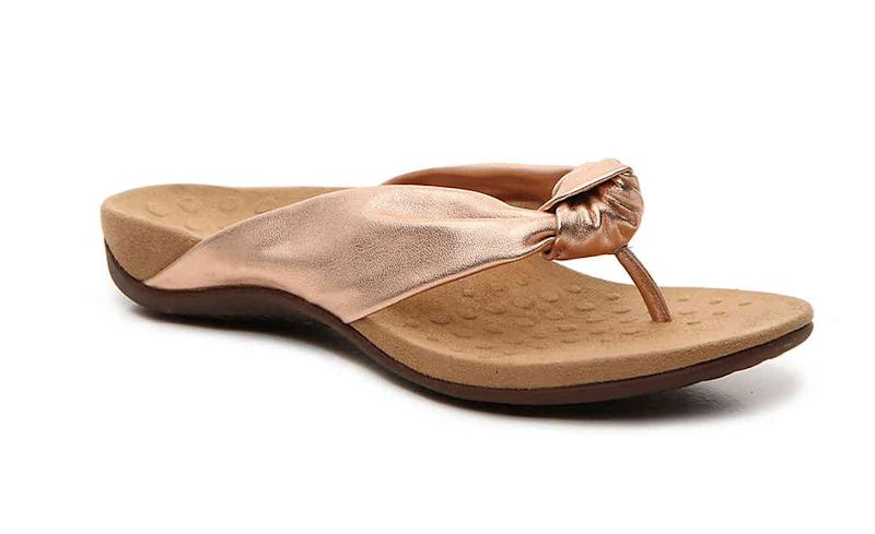 The deep, contoured footbed and sturdy straps on these sandals give this flip-flop style the rare seal of approval from the pros. (Photo: DSW)