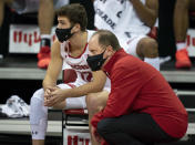 Wisconsin coach Greg Gard and guard Trevor Anderson watch from the bench during the second half of the team's NCAA college basketball game against Eastern Illinois Wednesday, Nov. 25, 2020, in Madison, Wis. Wisconsin won 77-67. (AP Photo/Andy Manis)