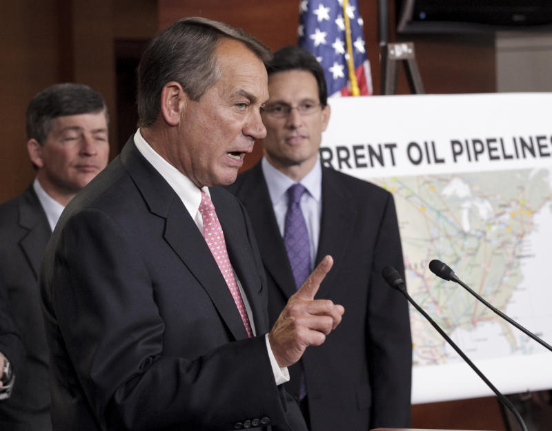 House Speaker John Boehner of Ohio, center, accompanied by House Majority Leader Eric Cantor of Va., right, and  Rep. Jeb Hensarling, R-Texas, gestures during a news conference on Capitol Hill in Washington, Wednesday, Jan. 18, 2012, to discuss President Barack Obama's decision to halt the Keystone XL pipeline.  (AP Photo/J. Scott Applewhite)