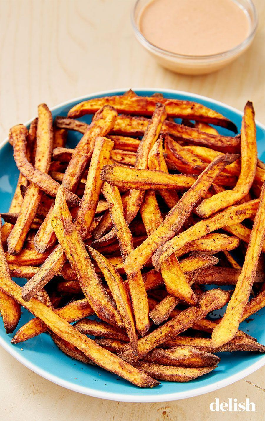 """<p>These are way crispier (and faster) than oven-baked sweet potato fries. </p><p>Get the recipe from <a href=""""https://www.delish.com/cooking/recipe-ideas/a28136123/air-fryer-sweet-potato-recipe/"""" rel=""""nofollow noopener"""" target=""""_blank"""" data-ylk=""""slk:Delish"""" class=""""link rapid-noclick-resp"""">Delish</a>.</p>"""