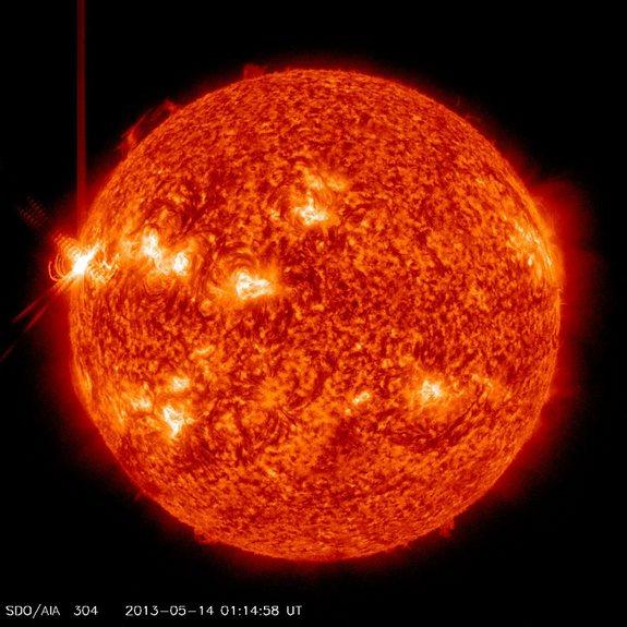 This image shows an X3.2 solar flare (far left) erupting from the sun late Monday (May 13, 2013) as seen by NASA's Solar Dynamics Observatory. It was the third major X-class solar flare in 24 hours.