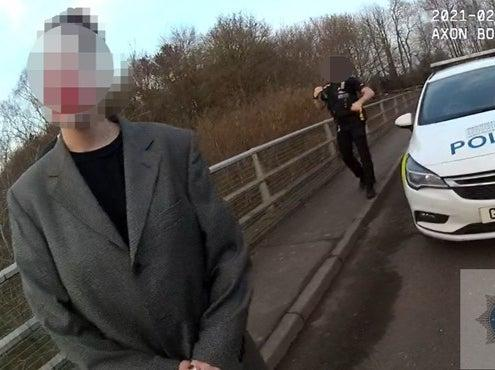 <p>A couple were fined for breaching coronavirus regulations after Kent Police officers found them on the wrong side of safety barriers on a bridge on Gracious Lane, Sevenoaks, carrying out a photoshoot</p> (Kent Police)