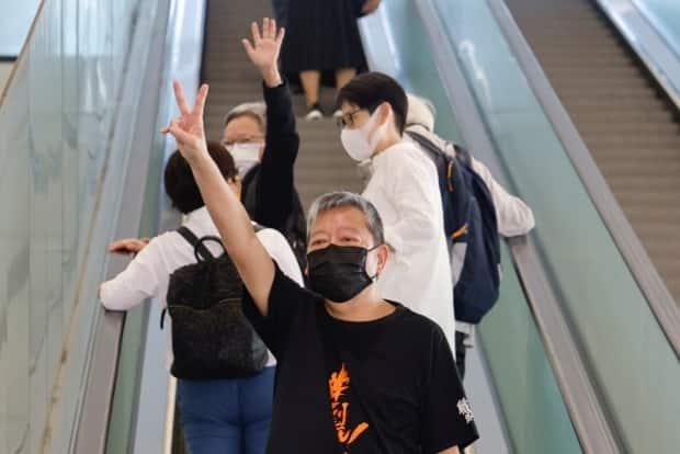 Pro-democracy activist Lee Cheuk-yan arrives at the West Kowloon Courts for verdicts in a landmark unlawful assembly case, in Hong Kong, China on Thursday. He was among seven veteran protesters found guilty of unauthorized assembly in August 2019, the latest blow to the city's beleaguered democracy movement. (Tyrone Siu/Reuters - image credit)