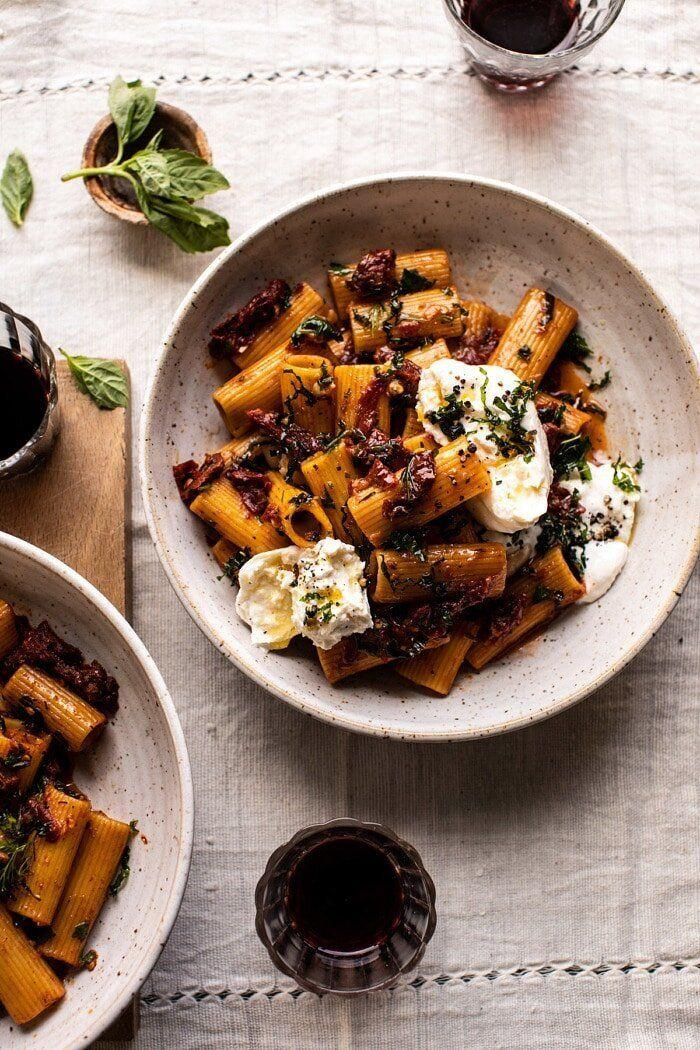 """<strong><a href=""""https://www.halfbakedharvest.com/quick-pantry-pasta/"""" target=""""_blank"""" rel=""""noopener noreferrer"""">Get theQuick Pantry Pasta withSun-Dried Tomatoes and Burrata recipe from Half Baked Harvest</a></strong>"""