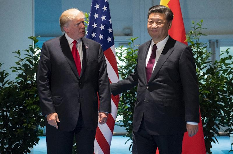 US President Donald Trump and Chinese President Xi Jinping (R) pictured prior to a meeting on the sidelines of the G20 Summit in Hamburg, Germany, on July 8, 2017 (AFP Photo/Saul LOEB)