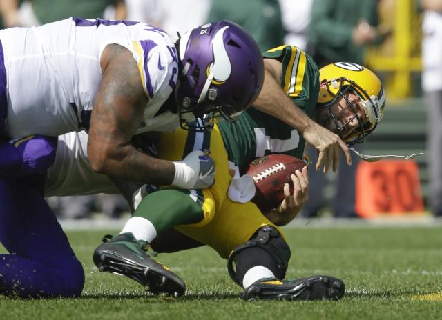 FILE - In this Sept. 16, 2018, file photo, Green Bay Packers' Aaron Rodgers is sacked by Minnesota Vikings' Sheldon Richardson during the first half of an NFL football game, in Green Bay, Wis. Richardson is two teams past his time with the New York Jets, refusing to acknowledge any desire for revenge on his original employer that traded him away. He's having a solid first season with the Vikings. The Vikings play at the New York Jets on Sunday, Oct. 21. (AP Photo/Jeffrey Phelps, File)