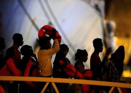Migrants disembark from an Armed Forces of Malta (AFM) patrol boat after 120 rescued migrants were brought to the AFM Maritime Squadron base at Haywharf in Valletta's Marsamxett Harbour, Malta October 7, 2018. REUTERS/Darrin Zammit Lupi