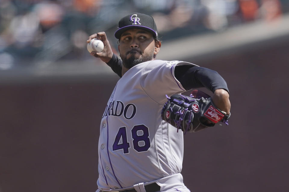 Colorado Rockies pitcher German Marquez (48) throws against the San Francisco Giants during the second inning of a baseball game in San Francisco, Sunday, April 11, 2021. (AP Photo/Jeff Chiu)