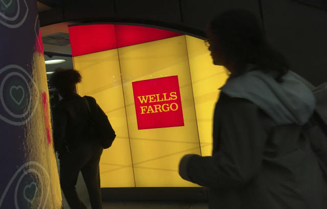 In this Thursday, Oct. 13, 2016, file photo, commuters walk by a Wells Fargo ATM location at New York's Penn Station. AP Photo/Swayne B. Hall, File