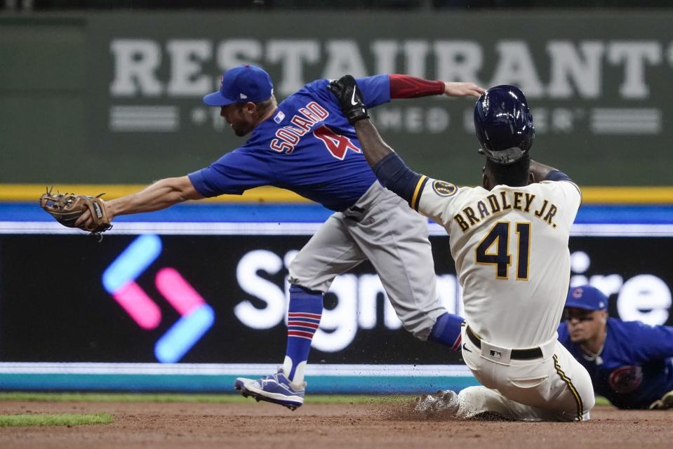 Milwaukee Brewers' Jackie Bradley Jr. is forced out at second with Chicago Cubs' Eric Sogard covering during the second inning of a baseball game Tuesday, April 13, 2021, in Milwaukee. (AP Photo/Morry Gash)