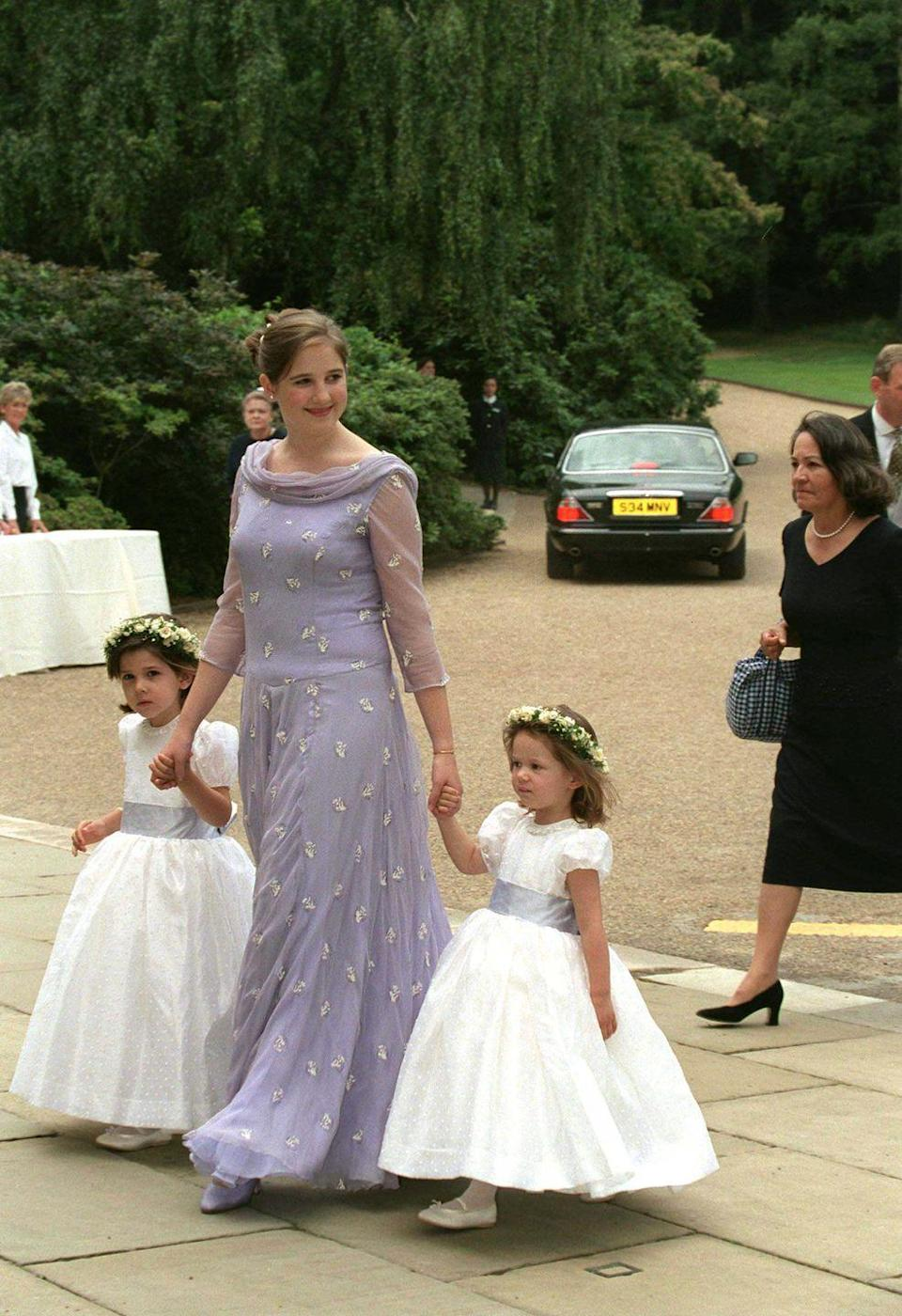 <p>Lavender replaced pink as one of the most popular colors for bridesmaid dresses in the '90s. Princess Theodora of Greece wore it to an English wedding, as seen on this beaded chiffon gown.</p>