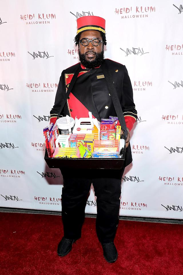 <p>The Roots drummer literally was the candy man in his movie-usher uniform. (Photo: Neilson Barnard/Getty Images for Heidi Klum) </p>
