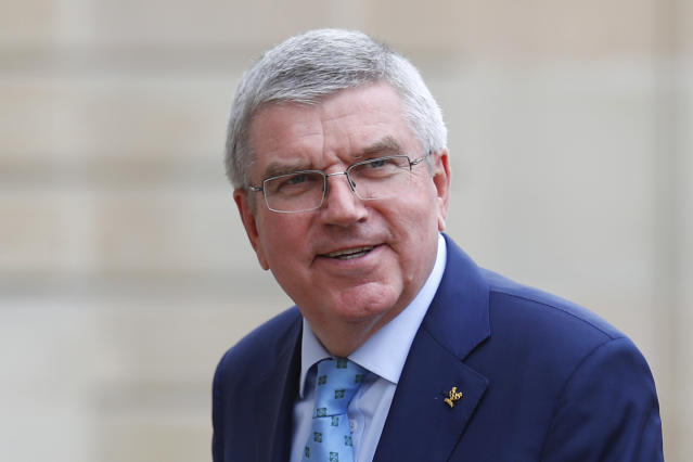In this June 7, 2019, photo, International Olympic Committee (IOC) president Thomas Bach arrives to meet French President Emmanuel Macron at the Elysee Palace in Paris. An international trade union wants Bach to intervene and investigate alleged labor and safety violations at venues being built for next year's Tokyo Olympics. (AP Photo/Francois Mori, File)