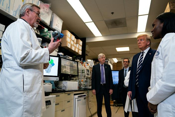 "Dr. Barney Graham, Deputy Director at the Vaccine Research Center at the National Institutes of Health, speaks with President Donald Trump during a lab tour on March 3, 2020, in Bethesda, Maryland. <p class=""copyright"">Evan Vucci/Associated Press</p>"