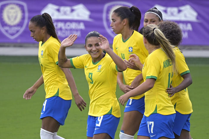 Brazil forward Debinha (9) celebrates after scoring a goal during the second half of a SheBelieves Cup women's soccer match against Argentina, Thursday, Feb. 18, 2021, in Orlando, Fla. (AP Photo/Phelan M. Ebenhack)