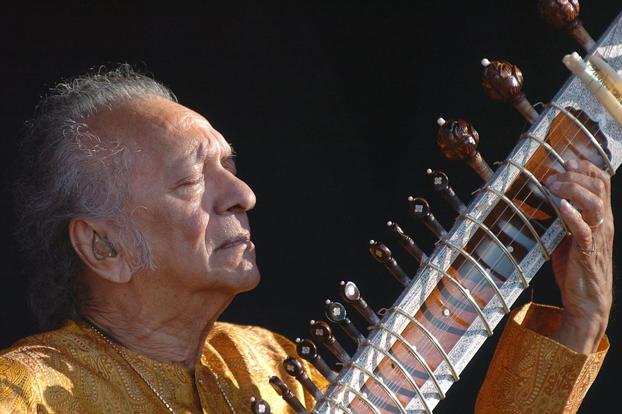FILE - In this July 19, 2005 file photo, Indian musician Ravi Shankar performs during the opening day of the Paleo Festival, in Nyon, Switzerland. Shankar, the sitar virtuoso who became a hippie musical icon of the 1960s after hobnobbing with the Beatles and who introduced traditional Indian ragas to Western audiences over an eight-decade career, died Tuesday, Dec. 11, 2012. He was 92. (AP Photo/Keystone, Sandro Campardo, File)
