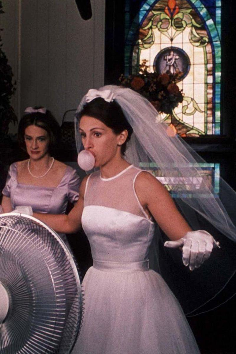 "<p>It wasn't the wedding that finally made the runaway bride say ""I do,"" but Maggie Carpenter's (Julia Roberts) full skirt and illusion-neckline gown for her wedding to Ike will forever be remembered as she rode off into the sunset on a FedEx truck.<br></p>"