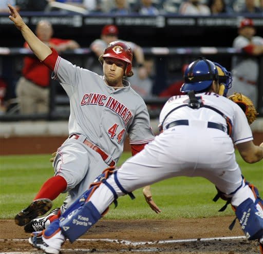 Cincinnati Reds' Mike Leake (44) scores ahead of the throw to New York Mets catcher Mike Nickeas on Reds' Zack Cozart's third-inning double during their baseball game at Citi Field in New York, Wednesday, May 16, 2012. (AP Photo/Kathy Willens)