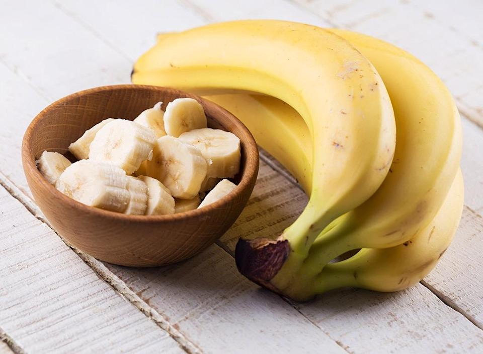"""The mighty banana that beats the 2 p.m. slump and makes its way into breakfast smoothies is actually known as the commercially-grown Cavendish species and its stricken by a deadly fungal infection that taints the soil. According to <a rel=""""nofollow noopener"""" href=""""http://www.foxnews.com/science/2018/07/06/bananas-on-brink-fruit-faces-extinction-risk.html"""" target=""""_blank"""" data-ylk=""""slk:Fox News"""" class=""""link rapid-noclick-resp"""">Fox News</a>, the soil-tainting Panama disease is currently spreading throughout Africa and Asia, and experts fear that if it strikes South America (the biggest supplier of Cavendish), that may mark the end of America's favorite fruit."""