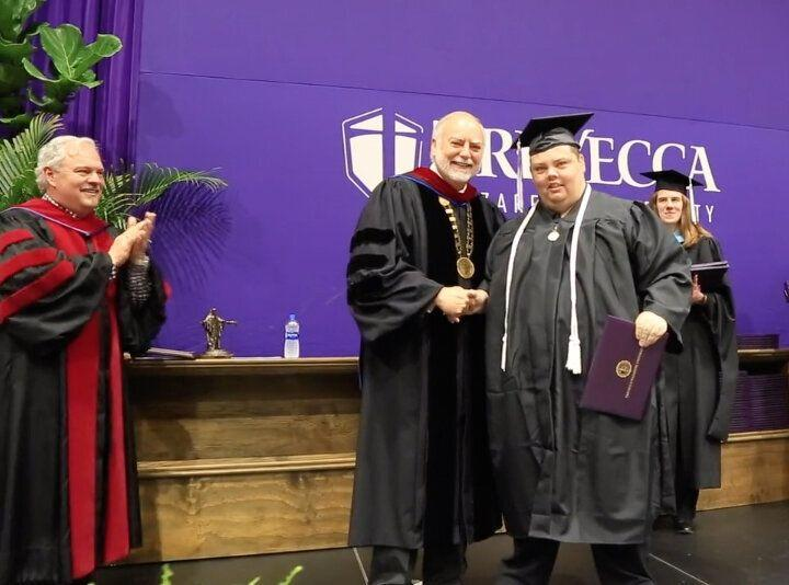 Brian Schnelle receives his college diploma from Trevecca Nazarene University President Dan Boone. (Credit: Trevecca Nazarene University)