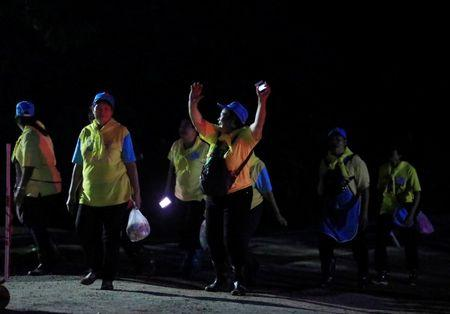Volunteers celebrate near Tham Luang cave complex in the northern province of Chiang Rai, Thailand, July 10, 2018. REUTERS/Soe Zeya Tun