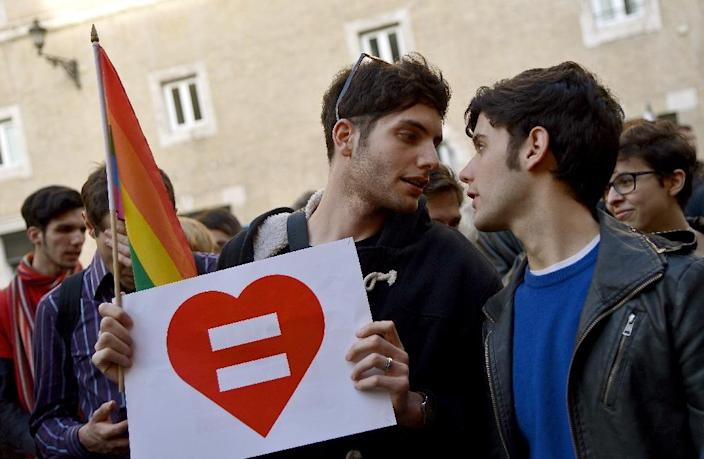 Supporters of same-sex civil unions demonstrate at the Piazza delle Cinque Lune in Rome on February 24, 2016 (AFP Photo/Filippo Monteforte)