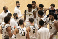Villanova's head coach Jay Wright, center left, talks things over with his team during the first half of an NCAA college basketball game against Providence, Saturday, Jan. 23, 2021, in Villanova, Pa. (AP Photo/Chris Szagola)