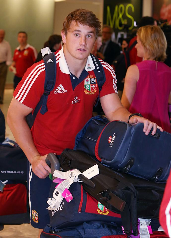 Jonathan Davies of the British and Irish Lions, arrives at Heathrow Airport, following their Test series triumph against Australia, just hours before the England cricket team pick up the baton.