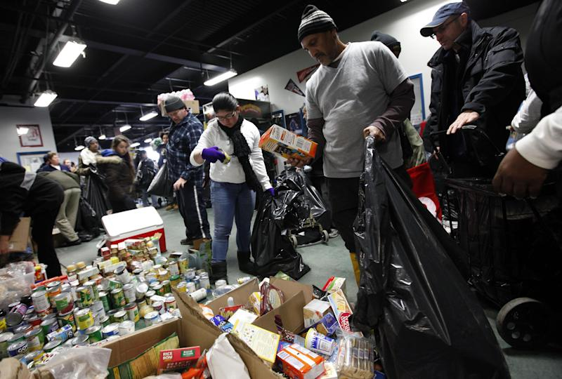 Storm victims browse through donated food items at a clothing and food distribution center, Monday, Nov. 5, 2012 in Long Beach, N.Y. (AP Photo/Jason DeCrow)