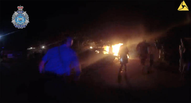 Body-camera vision shows a Western Australia police officer rushing toward a burning home with a child inside.