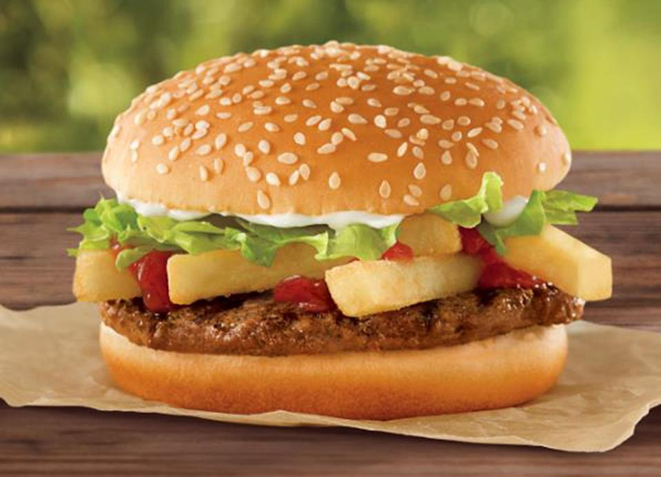 Burger King announced its latest menu addition, the French Fry Burger, a patty topped with four French fries for only $1. The burger, which will be available Sept. 1 and through the fall, according to the Associated Press, packs 360 calories and 19 grams of fat, but already seems to be drumming up excitement online. The new offering reportedly comes as the chain tries to gain ground in the fast-food wars against rival McDonald's Dollar Menu. (AP Photo/Burger King)