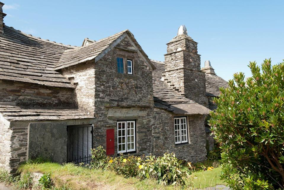 """<p>Charming period features and a pretty cottage garden make this one of the prettiest smaller National Trust properties in Cornwall. You can learn about rural life hundreds of years ago in the bedrooms and cosy parlour – with an original fireplace and furniture. Out in the hall, there's a Victorian clay oven for baking bread, while warped wooden beams add an extra dose of character.</p><p>Have a look around the post room to learn how the building got its name – it's always been a family home, but during the Victorian period it was also the village's letter receiving office, and you'll see antique telegraph equipment and an unusual old post box.</p><p><strong>Where to stay: </strong>Combine a visit here with a stay in Padstow, where the modern <a href=""""https://go.redirectingat.com?id=127X1599956&url=https%3A%2F%2Fwww.booking.com%2Fhotel%2Fgb%2Fpadstow-harbour-hotel.en-gb.html%3Faid%3D2070935%26label%3Dnational-trust-cornwall&sref=https%3A%2F%2Fwww.countryliving.com%2Fuk%2Ftravel-ideas%2Fstaycation-uk%2Fg35461727%2Fnational-trust-cornwall%2F"""" rel=""""nofollow noopener"""" target=""""_blank"""" data-ylk=""""slk:Padstow Harbour Hotel"""" class=""""link rapid-noclick-resp"""">Padstow Harbour Hotel </a>offers a fun, family-friendly stay. </p><p><a href=""""https://www.countrylivingholidays.com/offers/cornwall-padstow-harbour-hotel"""" rel=""""nofollow noopener"""" target=""""_blank"""" data-ylk=""""slk:Read our hotel review of Padstow Harbour Hotel"""" class=""""link rapid-noclick-resp"""">Read our hotel review of Padstow Harbour Hotel</a></p><p><a class=""""link rapid-noclick-resp"""" href=""""https://go.redirectingat.com?id=127X1599956&url=https%3A%2F%2Fwww.booking.com%2Fhotel%2Fgb%2Fpadstow-harbour-hotel.en-gb.html%3Faid%3D2070935%26label%3Dnational-trust-cornwall&sref=https%3A%2F%2Fwww.countryliving.com%2Fuk%2Ftravel-ideas%2Fstaycation-uk%2Fg35461727%2Fnational-trust-cornwall%2F"""" rel=""""nofollow noopener"""" target=""""_blank"""" data-ylk=""""slk:CHECK PRICES"""">CHECK PRICES</a></p>"""