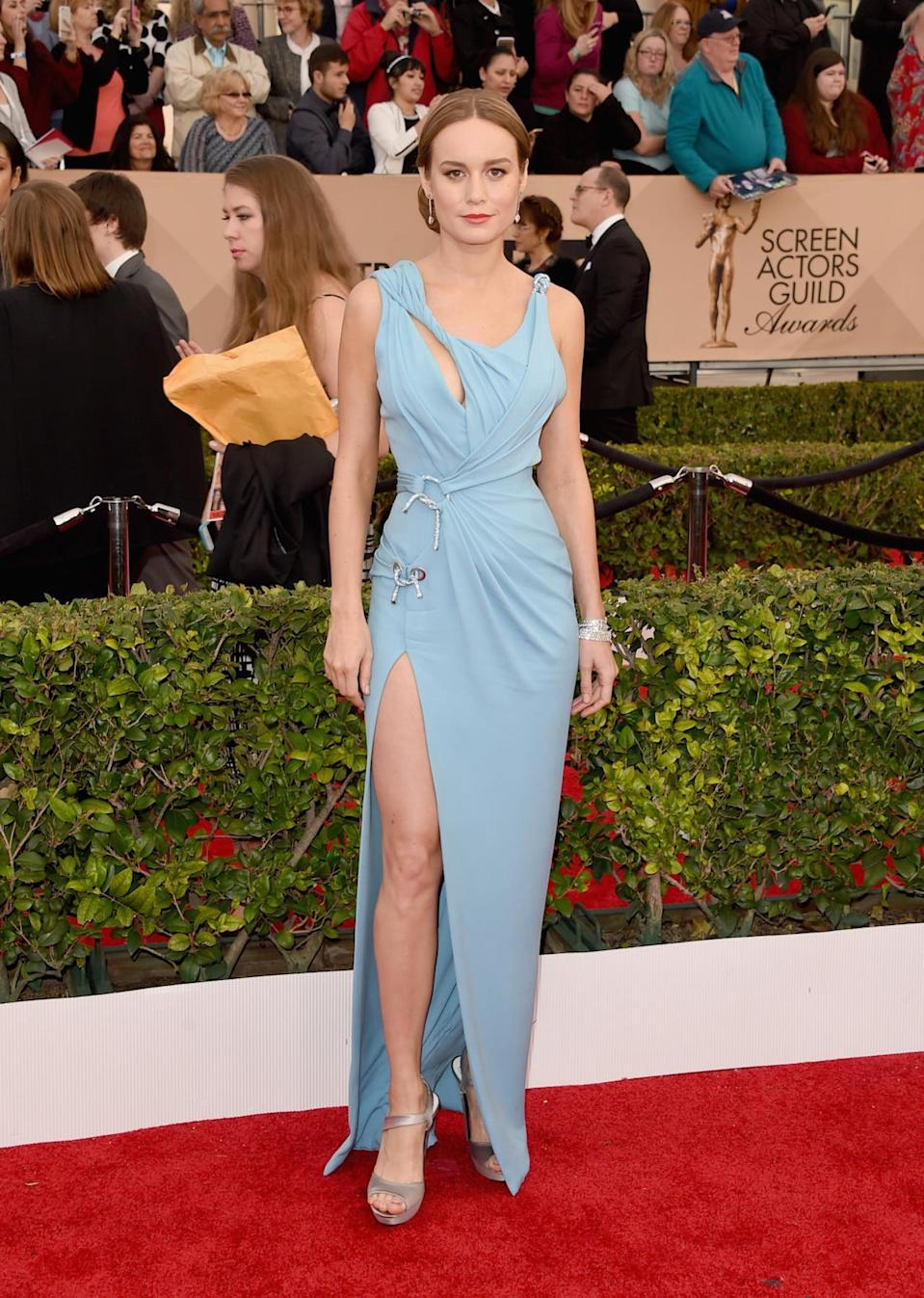 <p>It seems that jet lag leads to really good sartorial decisions! Brie Larson, who recently won a Golden Globe for her performance in <i>Room</i>, revealed that the light blue Versace dress she wore to the SAG Awards was the first dress she tried on after getting off a flight from Australia just days before. The knot , twist, and drape details from the front are cool and an orange strip of fabric from the back offers even ore awesomeness. <i>Photo: Getty Images</i></p>
