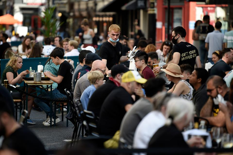 TOPSHOT - Customers eat sunday lunches at tables outside restaurants in Soho, in London on September 20, 2020 as the British government consider fresh nationwide restrictions after an rise in cases of the novel coronavirus. - The government this week tightened restrictions on socialising because of a surge in coronavirus cases, and imposed local lockdowns across swathes of the country. (Photo by DANIEL LEAL-OLIVAS / AFP) (Photo by DANIEL LEAL-OLIVAS/AFP via Getty Images)