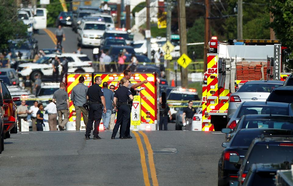 Police investigate after the shooting.
