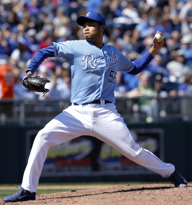 Kansas City Royals starting pitcher Bruce Chen delivers to a Chicago White Sox batter during the sixth inning of a baseball game at Kauffman Stadium in Kansas City, Mo., Saturday, April 5, 2014. (AP Photo/Orlin Wagner)
