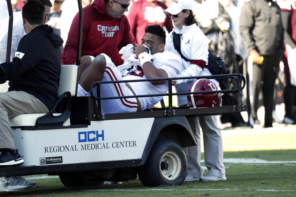 Alabama quarterback Tua Tagovailoa (13) is carted off the field after getting injured in the first half of an NCAA college football game against Mississippi State in Starkville, Miss., Saturday, Nov. 16, 2019. (AP Photo/Rogelio V. Solis)