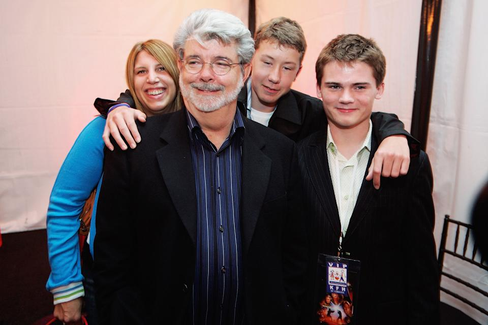 SAN FRANCISCO,  CA- MAY 12:  (L-R)  George Lucas director of Star Wars, Amanda Lucas, Jett Lucas and Jake Lloyd attend the after party of the San Francisco World Premiere of Star Wars: Episode III Revenge of the Sith at the Loews Theaters Metreon on May 12, 2005 in San Francisco, California. The Premiere was a benefit for the Koret Family House, which provides temporary housing for families of children with cancer and other serious illnesses while being treated at UCSF Children's Hospitial. (Photo by David Paul Morris/Getty Images)