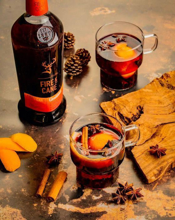 """<p>In a small pan add all the ingredients, combine 50ml <a href=""""https://www.amazon.co.uk/Glenfiddich-Experimental-Single-Scotch-Whisky/dp/B07JG4HDHC/ref=redir_mobile_desktop?ie=UTF8&aaxitk=ZO9xVlI8DKj3ak-sj2Tz2A&hsa_cr_id=1976778350002&pd_rd_r=ace82a02-5353-4dea-8a2e-ceda009dbdb8&pd_rd_w=5WiWC&pd_rd_wg=APYHR&ref_=sbx_be_s_sparkle_mcd_asin_1_img"""" rel=""""nofollow noopener"""" target=""""_blank"""" data-ylk=""""slk:Glenfiddich Fire & Cane,"""" class=""""link rapid-noclick-resp"""">Glenfiddich Fire & Cane,</a> 40ml sweet red wine, 20ml red grape juice, 10ml cinnamon syrup, 10ml Benedictine liquor and 2 cloves, 2 stars anise, 1 cinnamon stick and 1 orange peel. Heat for two minutes on a medium low heat, before straining, and garnishing with spices and an orange peel. <br></p>"""