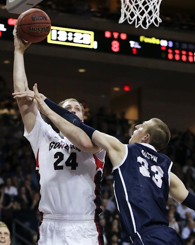 Gonzaga's Przemek Karnowski (24) puts up a shot against BYU's Nate Austin (33) in the first half of the NCAA West Coast Conference tournament championship college basketball game, Tuesday, March 11, 2014, in Las Vegas. (AP Photo/Julie Jacobson)