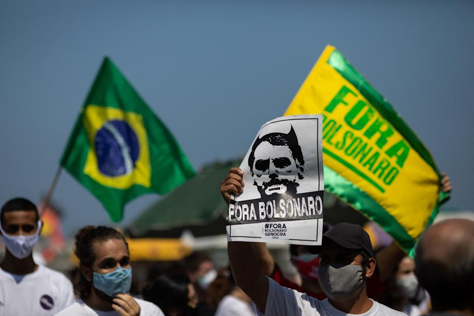 People take part in a demonstration called by right-wing groups and parties to demand the impeachment of Brazilian President Jair Bolsonaro, at Copacabana beach in Rio de Janeiro, Brazil, on September 12, 2021. (Photo by DOUGLAS SHINEIDR / AFP) (Photo by DOUGLAS SHINEIDR/AFP via Getty Images)