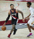 Portland Trail Blazers guard Gary Trent Jr., left, works around Cleveland Cavaliers guard Darius Garland during the second half of an NBA basketball game in Portland, Ore., Friday, Feb. 12, 2021. (AP Photo/Craig Mitchelldyer)