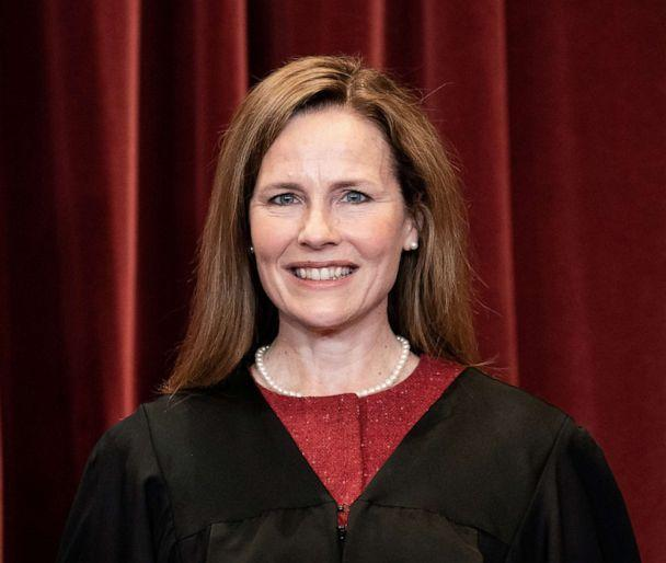 PHOTO: Associate Justice Amy Coney Barrett stands during a group photo of the Justices at the Supreme Court in Washington, D.C., April 23, 2021. (Erin Schaff/Pool via Getty Images)