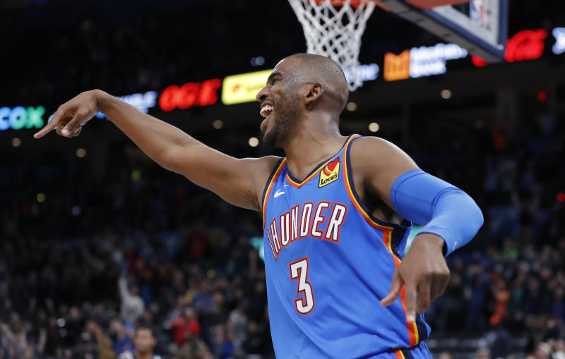 Dec 6, 2019; Oklahoma City, OK, USA; Oklahoma City Thunder guard Chris Paul (3) celebrates after guard Dennis Schroder made a basket to tie the game against the Minnesota Timberwolves at the end of regulation at Chesapeake Energy Arena. Oklahoma City won in overtime 139-127. Mandatory Credit: Alonzo Adams-USA TODAY Sports