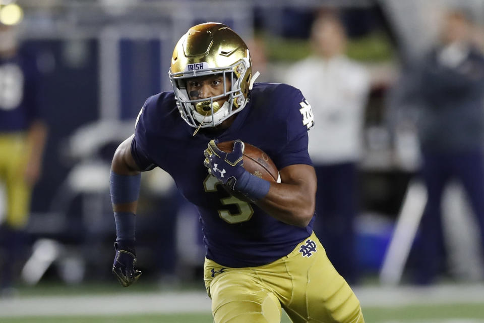 FILE - In this Sept. 29, 2018, file photo, Notre Dame's Avery Davis rushes during the second half of an NCAA college football game against Stanford in South Bend, Ind. Notre Dame junior Avery Davis is a case study in perseverance. He joined the Irish in 2017 as a dual-threat quarterback, then through attrition and position competition was moved to running back in 2018, then to cornerback to start this season before injuries brought him back to running back. Davis scored some credibility, and his first collegiate touchdown, last weekend to give the seventh-ranked Irish a boost heading to a showdown at No. 3 Georgia. (AP Photo/Carlos Osorio, File)