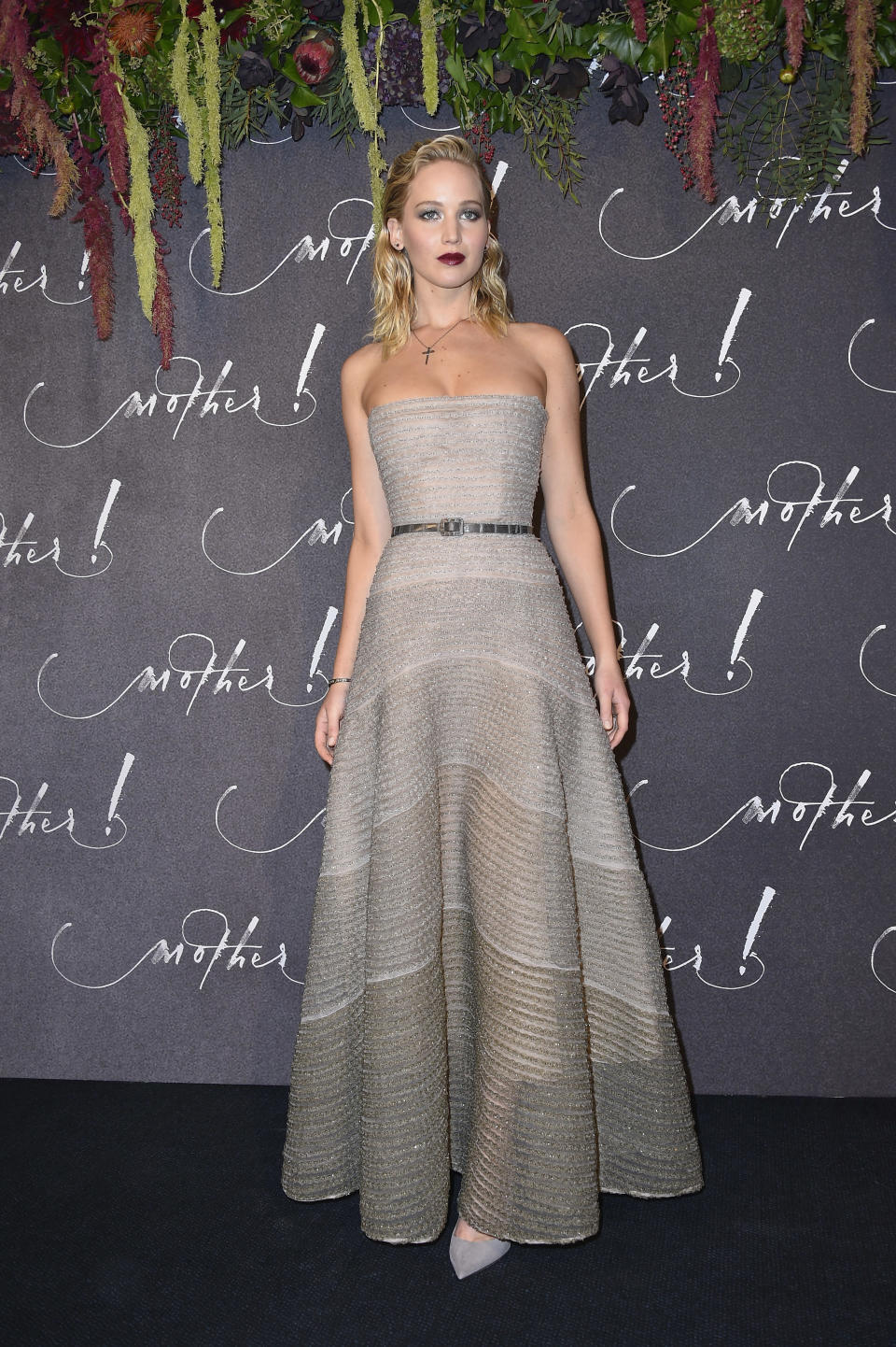 <p>Another Dior creation was worn in Paris. This time, Jennifer chose a strapless grey design, letting her wet look hair and red lips take centre stage.<br><i>[Photo: Getty]</i> </p>
