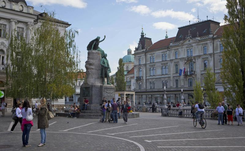 """A view of a square in downtown Ljubljana, Slovenia, Tuesday, Sept. 25, 2012. Once the envy of the former European communist states because of its booming economy and Western-style living standards, Slovenia is becoming a showcase of failed transition, government mismanagement and bad loans. Andrej Plut has always thought he was fortunate to live in Slovenia, at one time the most prosperous of the former republics of Yugoslavia and a star among the eastern European states that joined the EU after the fall of communism. The 55-year-old dentist can't figure out what went wrong with his tiny Alpine state, which now faces one of the worst recessions and financial system collapses among the crisis-stricken 17-country group that uses the euro. """"We used to live so well,"""" Plut said. """"Now, we don't know what tomorrow brings."""" (AP Photo/Darko Bandic)"""