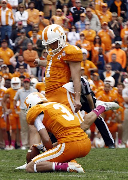 Tennessee kicker Michael Palardy (1) kicks a field goal as time expires in the fourth quarter to give his team a 23-21 victory over South Carolina in an NCAA college football game on Saturday, Oct. 19, 2013 in Knoxville, Tenn. Tennessee wide receiver Tyler Drummer (3) is holding. (AP Photo/Wade Payne)