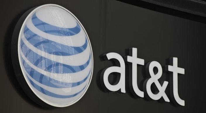 Image of AT&T (T) logo on a gray storefront